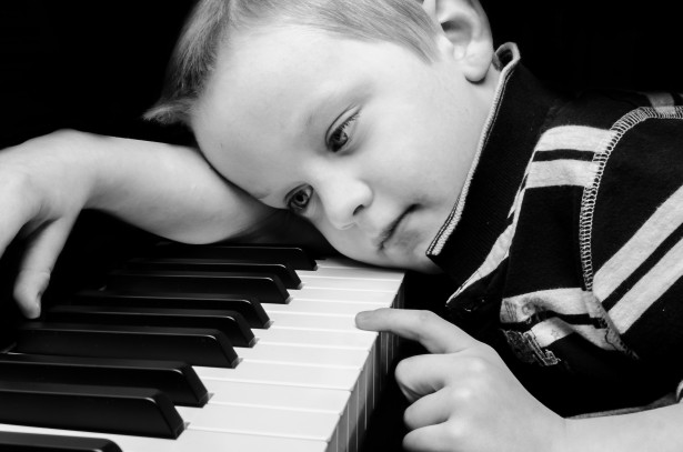 sad-boy-plays-piano.jpg