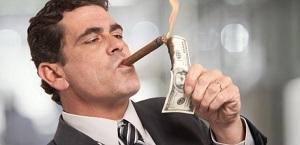 Rich-HNWI-billionaire-lighting-cigar-Shutterstock-740x360.jpg