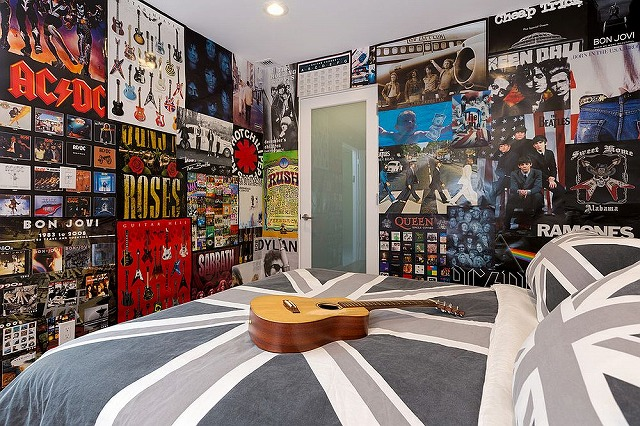 Teen-room-filled-with-posters-and-a-Union-Jack-bedding.jpg