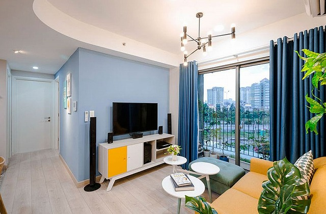 View-of-the-city-from-the-living-room-in-blue-and-yellow.jpg